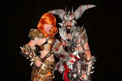 People dressed as barbarians from the video game Diablo 3 pose at the London Film and Comic Con 2014 in Earls Court, west London, on July 13, 2014. The event lets enthusiasts purchase rare items before getting the chance to meet film stars, TV actors, wrestlers and other personalities in the signing and photo zones.  AFP PHOTO / LEON NEALLEON NEAL/AFP/Getty Images ORG XMIT: