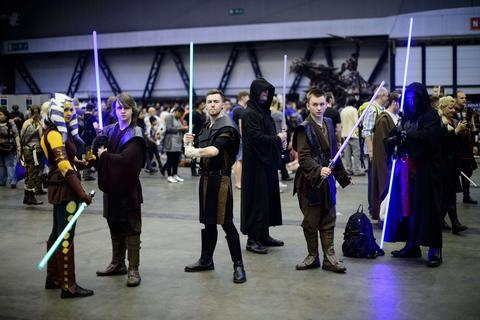 Fans dressed as Jedi Knights from the Star Wars universe at the London Film and Comic Con 2014 in Earls Court, west London, on July 13, 2014. The event lets enthusiasts purchase rare items before getting the chance to meet film stars, TV actors, wrestlers and other personalities in the signing and photo zones. AFP PHOTO / LEON NEALLEON NEAL/AFP/Getty Images ORG XMIT: