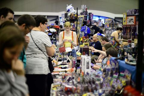 Fans browse the memorabilia stalls at the London Film and Comic Con 2014 in Earls Court, west London, on July 13, 2014. The event lets enthusiasts purchase rare items before getting the chance to meet film stars, TV actors, wrestlers and other personalities in the signing and photo zones.  AFP PHOTO / LEON NEALLEON NEAL/AFP/Getty Images ORG XMIT: