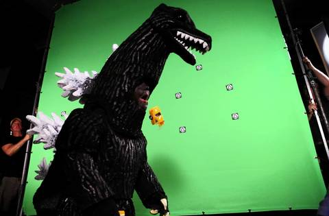 Maddex, 5, spits out half of a toy car while he plays the lead roll on the film set of 'Madzilla.'