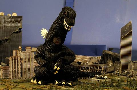 Maddex anxiously waits to destroy a miniature version of Chicago. The boy's wish was to star in his own movie, destroy buildings, take a bite out of a vehicle, breathe fire, scare people, come out of the water and fight Godzilla nemeses Baragon and MeccaGodZilla.