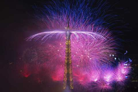 "Fireworks light up the sky near the Eiffel Tower in a show called ""Guerre et Paix"" (War and Peace) as part of events to mark the centenary of the First World War and to end the traditional Bastille Day celebrations in Paris, July 14, 2014."