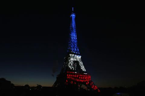 The Eiffel Tower is illuminated before the traditional Bastille Day fireworks display in Paris July 14, 2014.