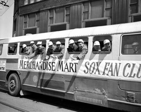 The Merchandise Mart Sox Fan Club members whoop it up as they leave for the White Sox opening day game on April 16, 1953.