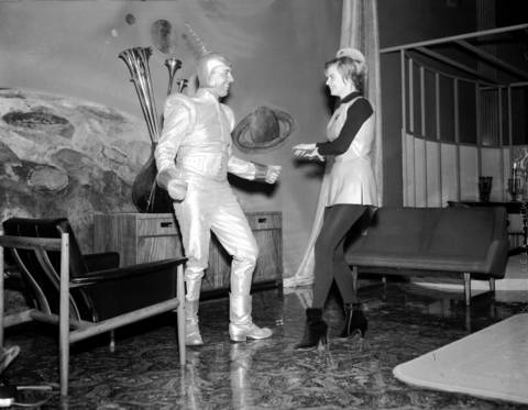 """Milton A. Botterill and Shela Wilson do the twist inside the """"Place In Space"""" display in the lobby of the Merchandise Mart on Jan. 8, 1962."""