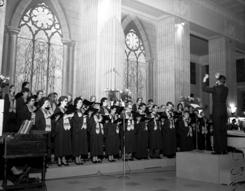 """The Merchandise Mart Chorus, made up of 40 voices, sang """"The Crucifixion"""" conducted by Francis Gregory. The group sang for 45 minutes in the lobby of the Merchandise Mart on March 29, 1961."""