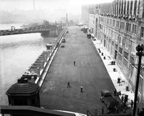 Known as Mart Center Drive today, the then new and un-named drive in front of the Merchandise Mart under construction in 1930.