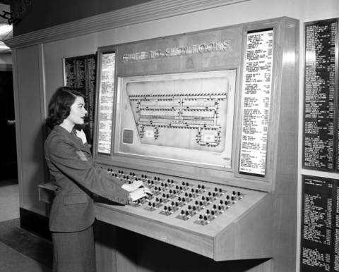Helyn Schnaufer operates the Magic Board on March 22, 1951, which was installed in the Merchandise Mart to direct buyer traffic. The board was valued at $5,000 in 1951.