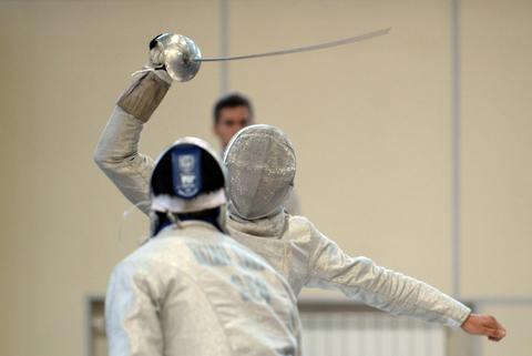 Maxence Lambert of France (R) competes against Sandro Bazadze of Georgia during the men's sabre qualification competition at the World Fencing Championships in Kazan, on July 15, 2014.