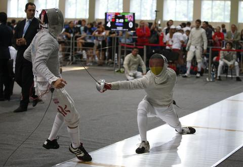 Germany's Matyas Szabo (R) and Hong Kong's Yan Hon Pan compete during their men's sabre qualification event at the World Fencing Championships in Kazan, July 15, 2014.