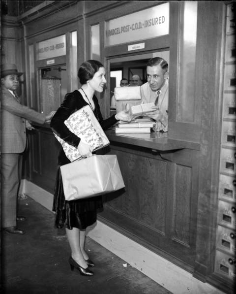 The Merchandise Mart post office opened with Ethel R. Bromberg mailing packages with help from postal clerk H. Edelman in 1930. The massive building has more than 4,000,000 square feet of floor space and once boasted its own zip code, as well as post office.