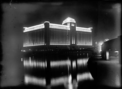 A night view of the Merchandise Mart. Undated photo.