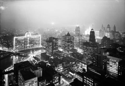 The original caption printed with this photograph on Dec. 15, 1956 said it all: Camera captures on film, forever, a veritable Christmas fairyland of lights, sparkling like sequins on satin. Photo was taken shortly before most Loop offices close, from atop Kemper Insurance Building, 20 W. Wacker Dr. You're looking east from atop the 45-story building across Chicago River. That's the Merchandise Mart in the left background, with 'Merry Christmas' emblazoned across its massive facade and reflecting in the water.