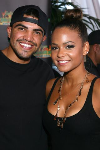 Actress Christina Milian and boxer Victor Ortiz attend the GBK Luxury Sports Lounge prior to the ESPY Awards.