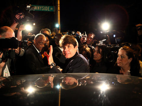"Former Gov. Rod Blagojevich, who was convicted on corruption charges, waves as he leaves his home in Chicago for a federal prison in Colorado. ""I'll see you around,"" he told the crowd. Click here to see more photos of Blagovich heading to prison."