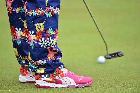 John Daly is decked out in SpongeBob Squarepants pants while getting in a practice round on Wednesday before the start of the British Open at Royal Liverpool in Hoylake, England, on Thursday.