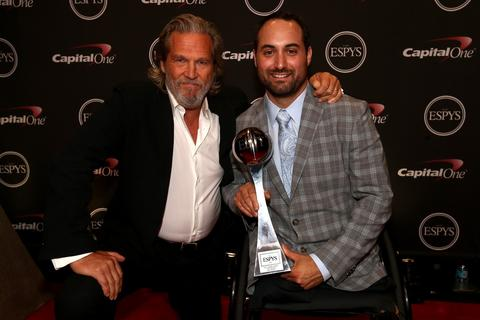 Actor Jeff Bridges presents the Pat Tillman award for service to Josh Sweeney at the ESPY Awards attends The 2014 ESPYS at Nokia Theatre L.A. Live.