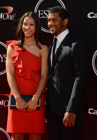 Seattle Seahawks quarterback Russel Wilson (right) arrives at the 2014 ESPY Award show with his sister Anna Wilson at Nokia Theatre.