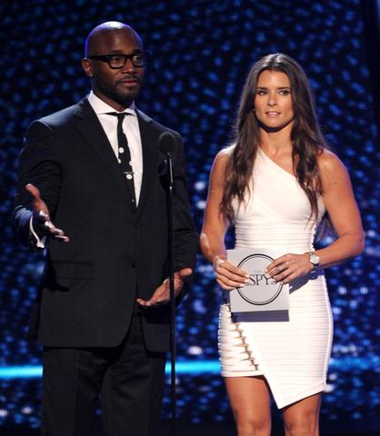 Actor Taye Diggs and NASCAR driver Danica Patrick speak onstage.