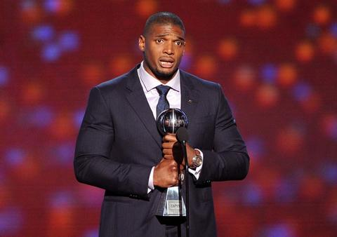 NFL player Michael Sam accepts the Arthur Ashe Courage Award.
