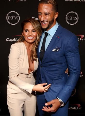 Model Chrissy Teigen and NFL quarterback Colin Kaepernick backstage.