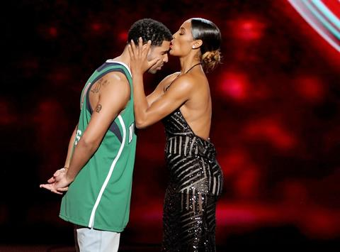 ESPYs host Drake gets a kiss from WNBA player Skylar Diggins onstage.