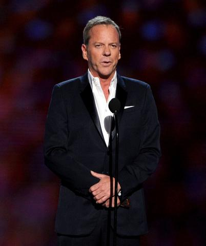 Actor Kiefer Sutherland speaks onstage.