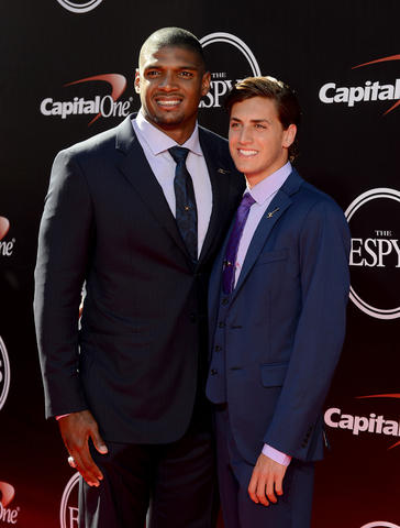 St. Louis Rams defensive end Michael Sam(left) and partner Vito Cammisano arrive at the 2014 ESPY Award show.