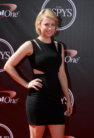 Comedian Iliza Shlesinger arrives at the 2014 ESPY Award show.