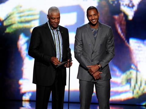 NBA legend Julius Erving and New York Knicks star Carmelo Anthony speak onstage.