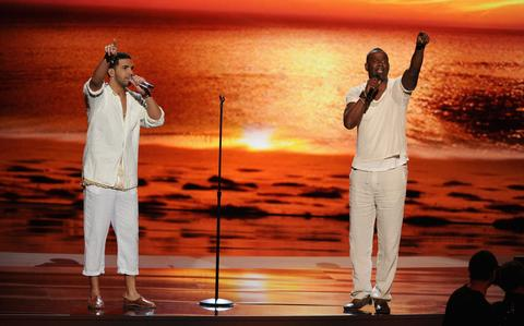 Host Drake (left) and singer Brian McKnight perform onstage.