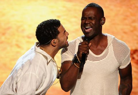 Drake (left) and singer Brian McKnight perform onstage.