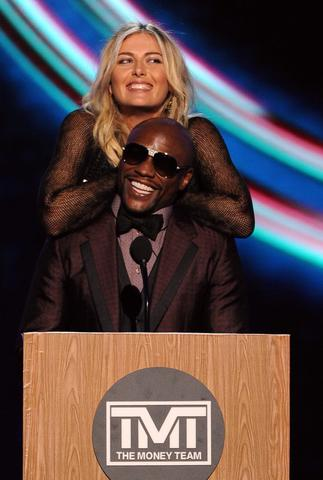 Tennis player Maria Sharapova and boxer Floyd Mayweather Jr. speak onstage.