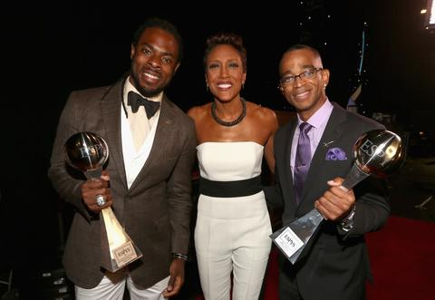 NFL player Richard Sherman poses with broadcasters Robin Roberts and Stuart Scott backstage