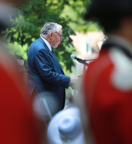 U.S. District Court for the Eastern District of Virginia held a naturalization ceremony at the Colonial Capitol, Williamsburg. Framed by the Colonial Williamsburg Fifes and Drums, Colin G. Campbell, president and CEO, The Colonial Williamsburg Foundation, delivers welcoming remarks.