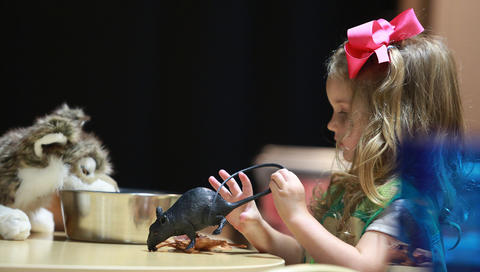 The Virginia Living Museum introduces a new permanent exhibit that will allow children to learn about veterinary work. Some children were selected for a soft opening to feed and care for animals much like the staff of VLM does. Julia McClurg, 3, may be considering a rat as a suitable wolf entree.