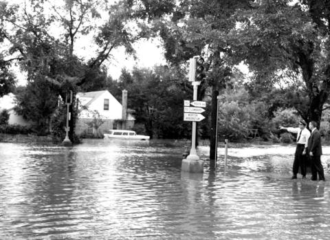 Sept. 15, 1961: Lisle Police Sgt. Henry Stanek and Village Trustee Paul M. Allen survey the flooded area at the corner of Lincoln Avenue and Burlington.