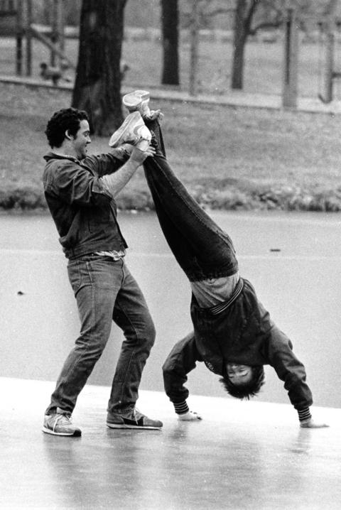 Dec. 30, 1986: Defying the dangers of their play, Joe Ritscherle, 18, holds Marty Black, 16, on a frozen portion of a pond in Lisle. The ice was barely frozen near where the pair was cavorting.
