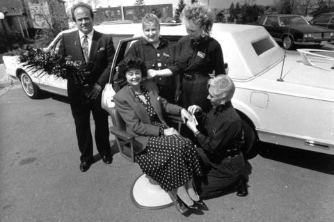 May 14, 1989: Customer Rita Harvard gets the royal treatment from La Finesse salon employees.