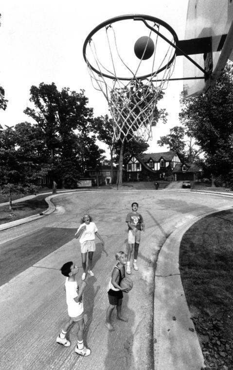 Sept. 10, 1990: The Driftwood Court basketball backboard keeps neighborhood players busy.