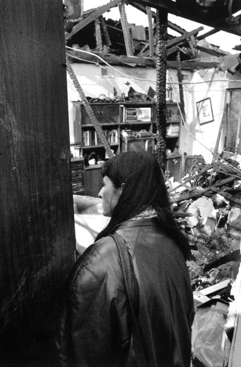 Oct. 23, 1991: Frances Coleman surveys the remains of her third floor apartment after a fire at the Lakeside Apartment Complex. A malfunctioning heater may have caused the blaze, a fire official said.