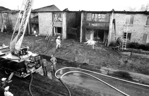 Oct. 24, 1991: Firefighters survey the damage of an apartment fire at the Lakeside Apartment Complex at 4800 Lake Trail Drive in Lisle.