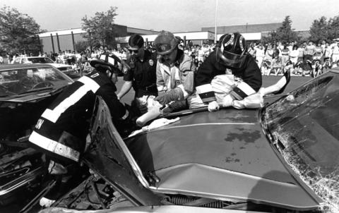 May 25, 1990: Officials from the Lisle-Woodridge Fire District stage a mock accident Thursday at Lisle Senior High School to demonstrate the dangers of drunken driving.