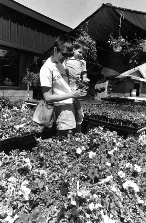 June 6, 1990: Ann Cullinane and her son Philip, 2, try to choose among the flowers at Joe's Flower Shop on Illinois Highway 53 in Lisle.