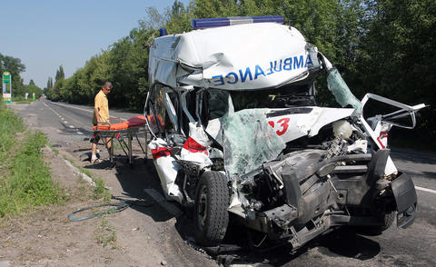 The wreckage of an ambulance sits on the roadside on the outskirts of the city of Donetsk, Ukraine, on July 23 after being hit by shelling.