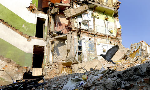 A pigeon flies over the debris of  a destroyed blockhouse in the city of Snizhne, Ukraine, on July 22.