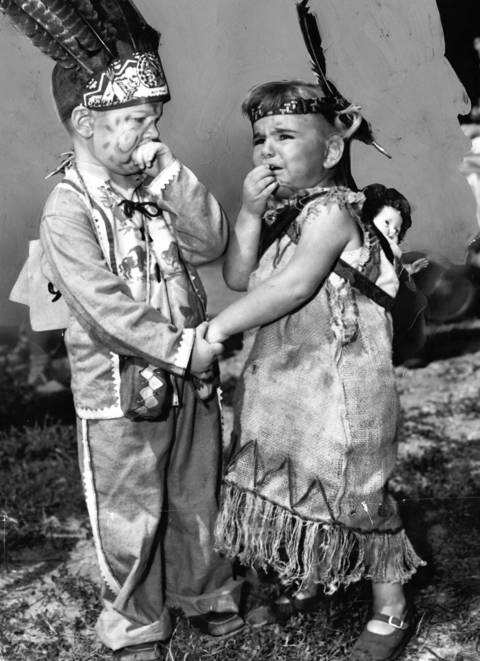 Aug. 7, 1952: Costumed children Thatcher Drew, 3, and Pattie Bellairs, 2, participate -- perhaps somewhat reluctantly -- in the Wilmette County Fair children's parade.