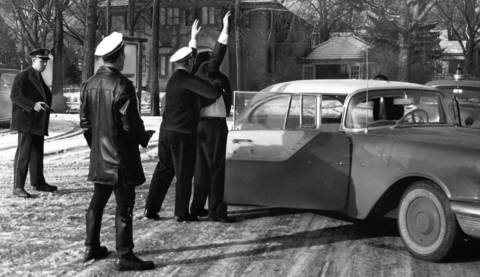 Feb. 11, 1956: Officers arrest a suspect believed to be involved in a robbery of First Federal Savings and Loan Association. Two others were also arrested.