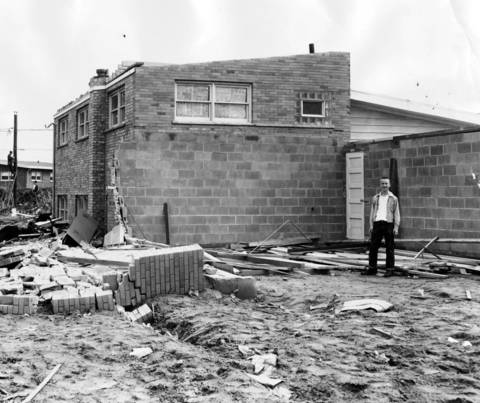 April 2, 1956: A resident tours a damaged home and garage on the 400 block of Circle Drive in Wilmette after a severe wind storm.