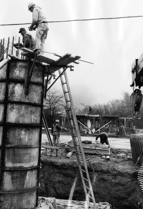 April 1, 1976: Crews work on a new bike and horse bridge on Lake Street between Harms and Wagner roads.